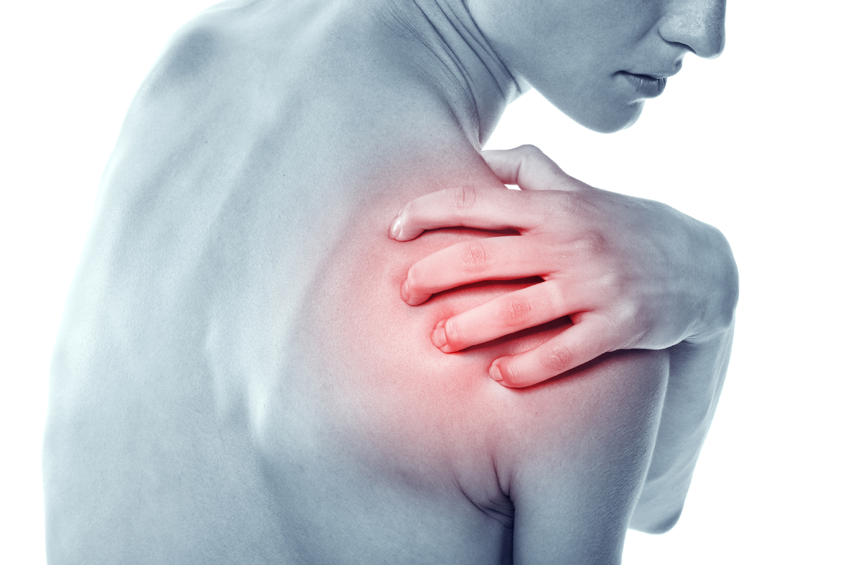 Acute pain in a shoulder at the young women. young girl keeps for a sick shoulder on a white background